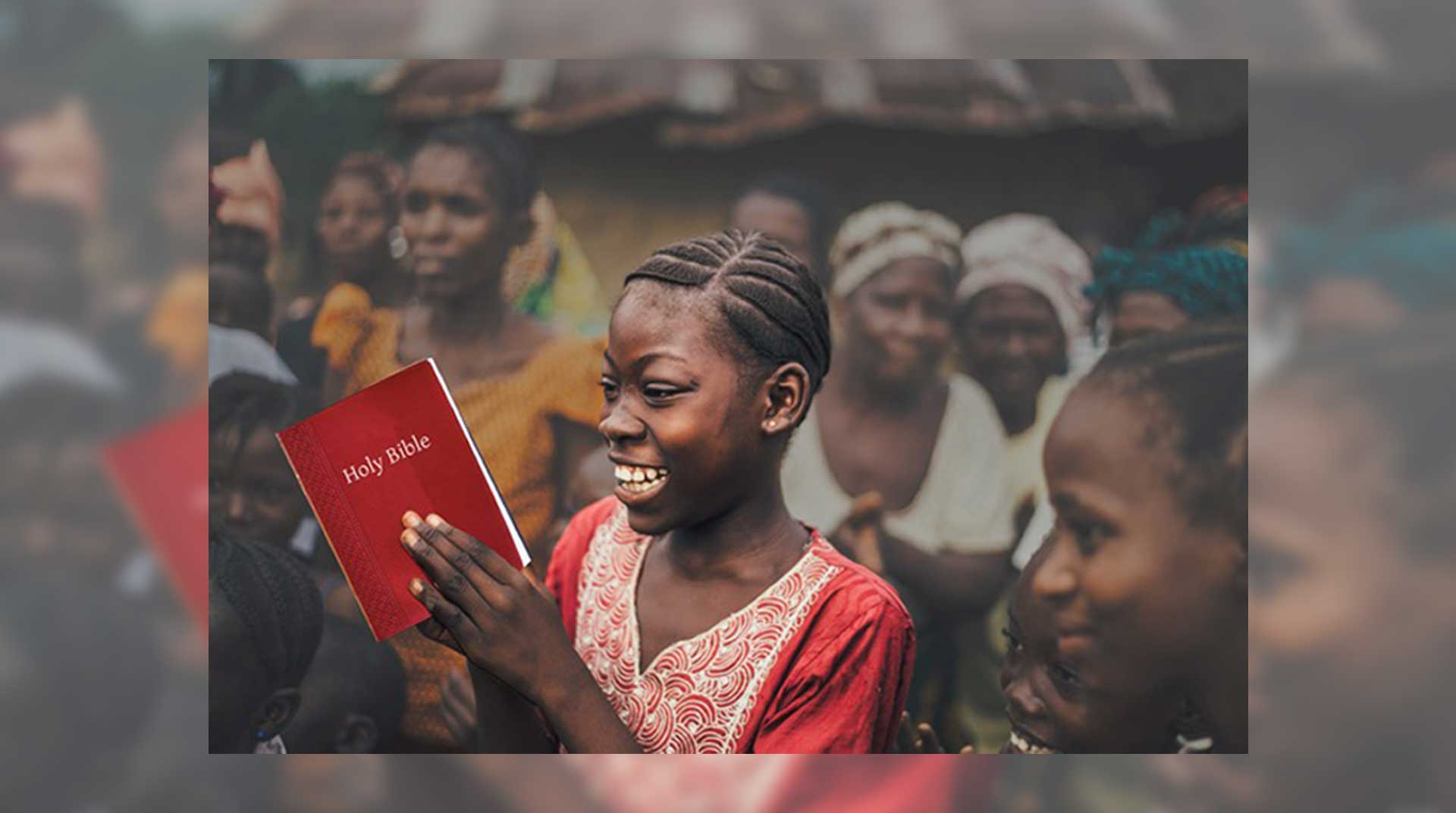 Smiling girl with Bible