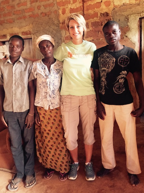 Stephenie Carroll with her sponsored kids, John and Gift, and their aunt.